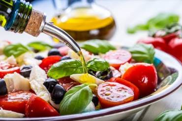 How the Mediterranean Diet with olive oil shields the human body against COVID-19